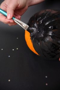 Paint the pumpkin black